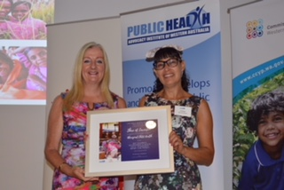 Jo Morgan receiving the award from Mayor Tracey Roberts